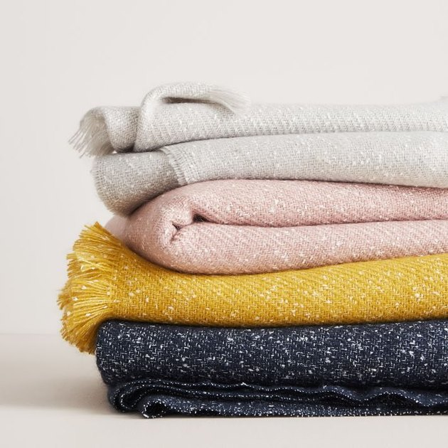 speckled throw blankets in a pile