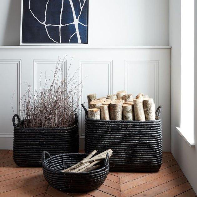 three black baskets near white wall