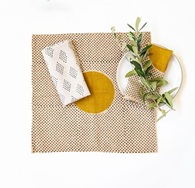 napkin with geometric pattern and dish nearby