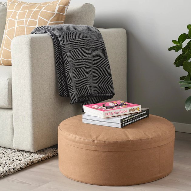 pouffe near gray couch
