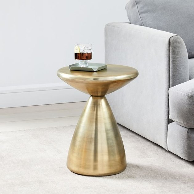 gold side table near gray couch