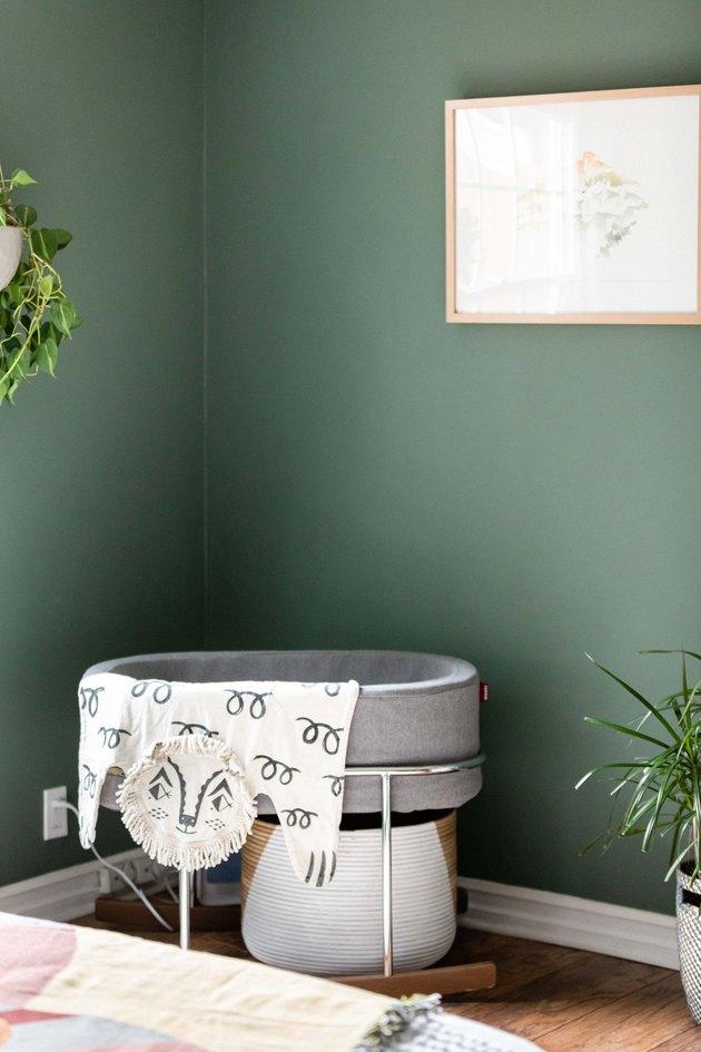 crib near green wall