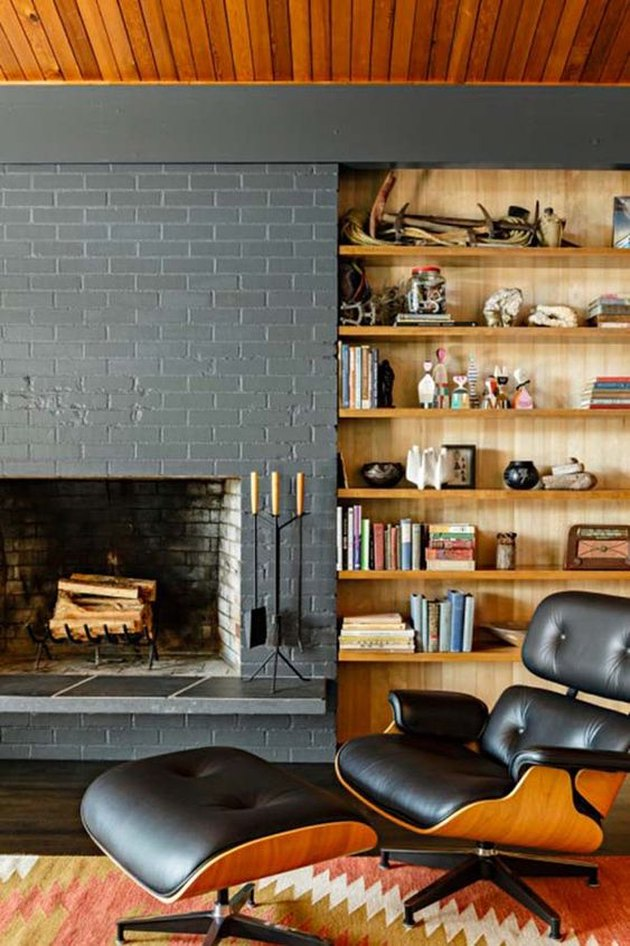 midcentury fireplace with gray brick surround