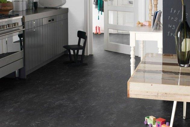 Black linoleum flooring in a kitchen
