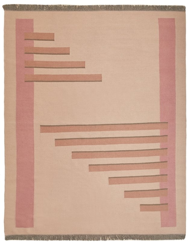 Minimal geometric rug featuring two shades of blush.