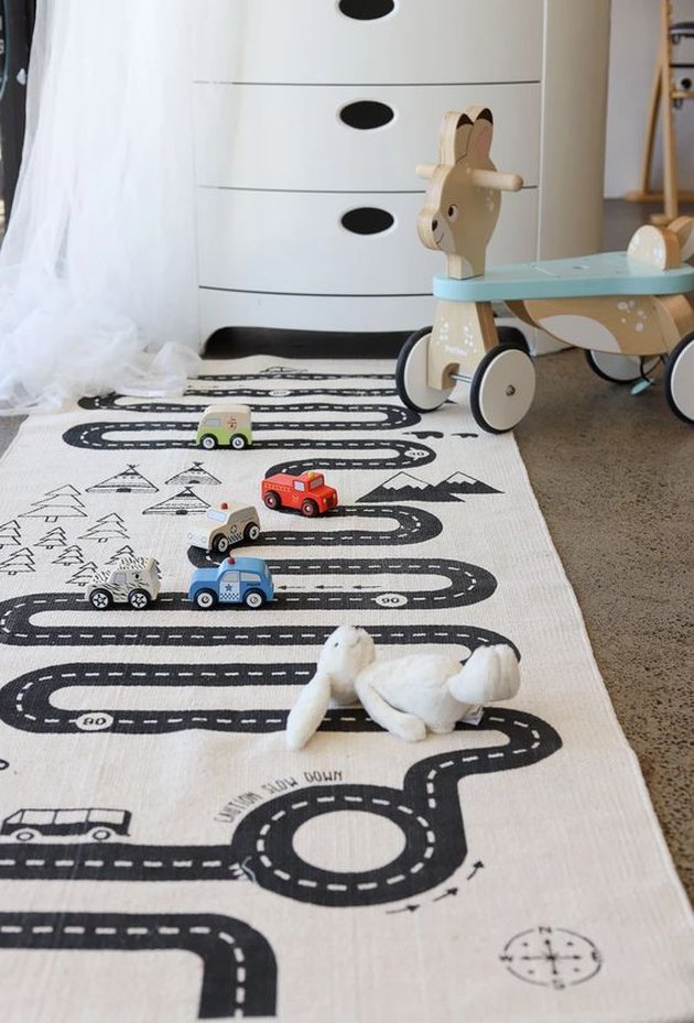 playroom decor with adventure road map rug and toys on floor