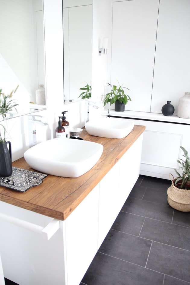 white bathroom with wood countertop