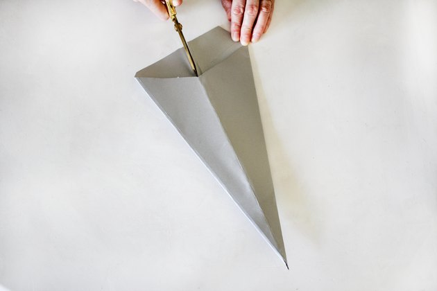 Cutting slit in center of cone shape