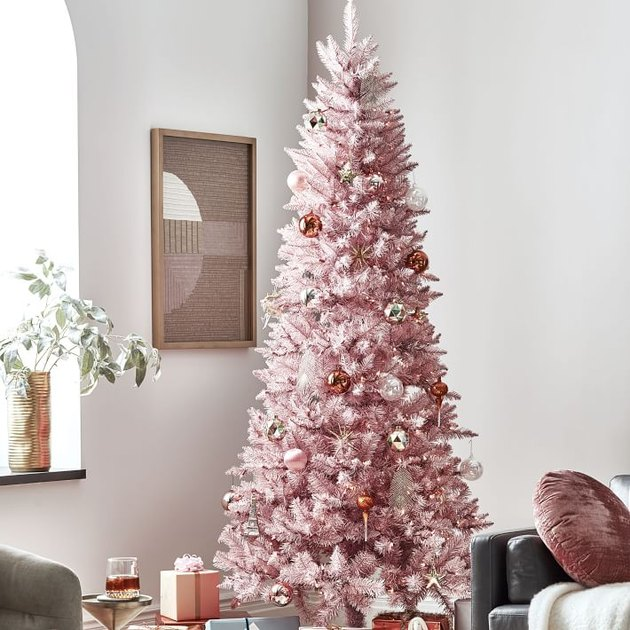 pink decorated Christmas tree in living room