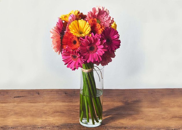 pink and orange flowers in a vase