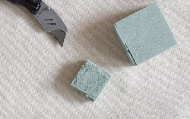 Cutting small square of floral foam