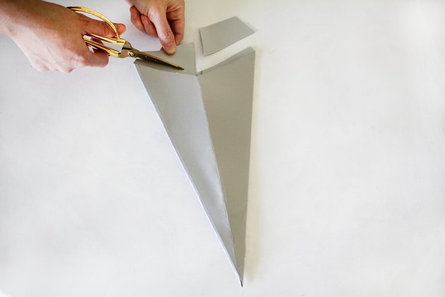 Cutting off excess paper from cone shape