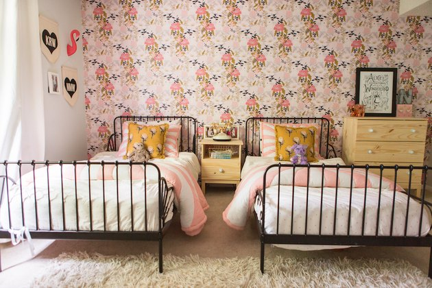 floral wallpaper and black IKEA beds in pink kids bedroom idea