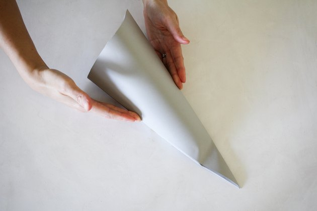 Puffing paper shape into three dimensional cone