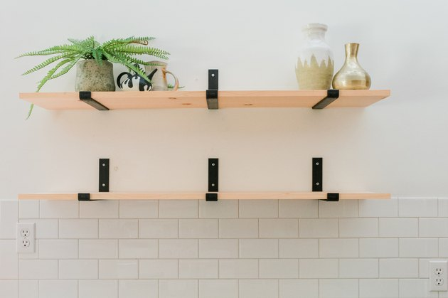 Use the upper shelf to hold keepsakes that aren't used every single day.