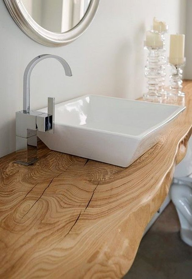 white bathroom with live edge wood countertop and chrome fixtures