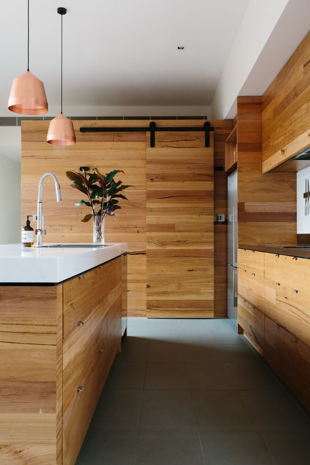 concrete kitchen floor in minimalist kitchen with wood cabinetry