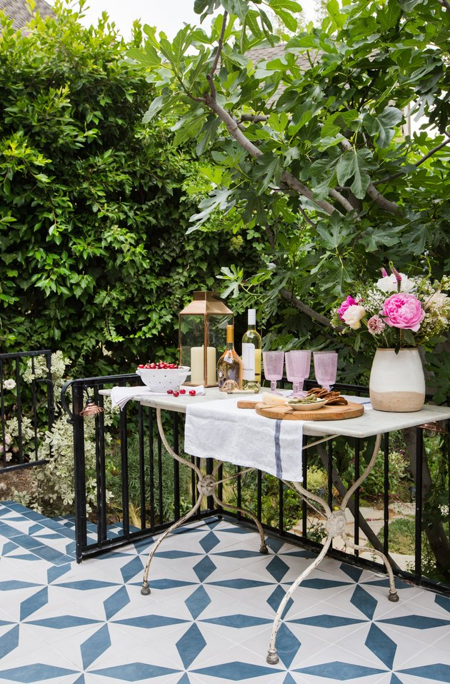 outdoor party idea with pink and white food and drink table station