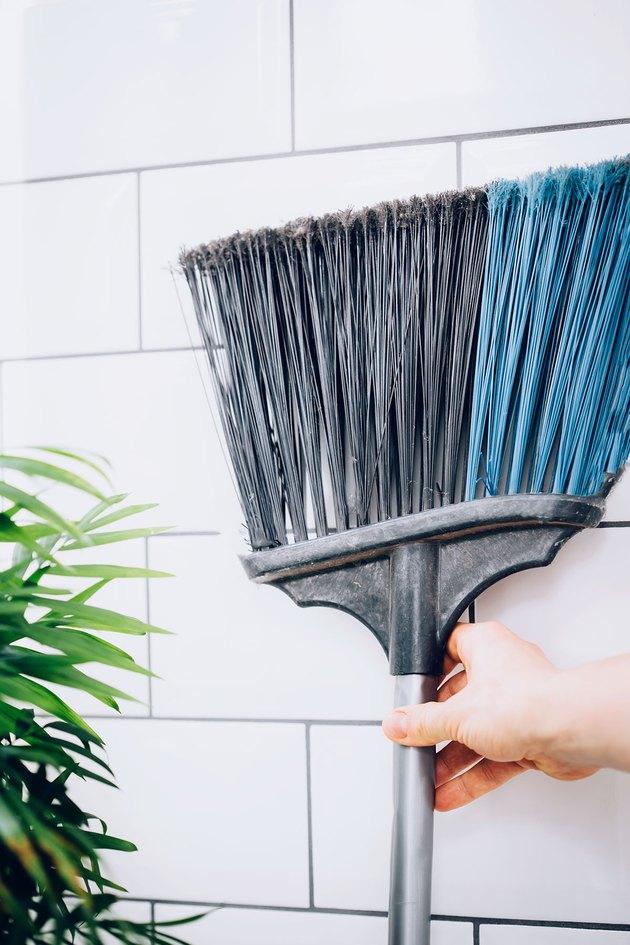 Store brooms upside down