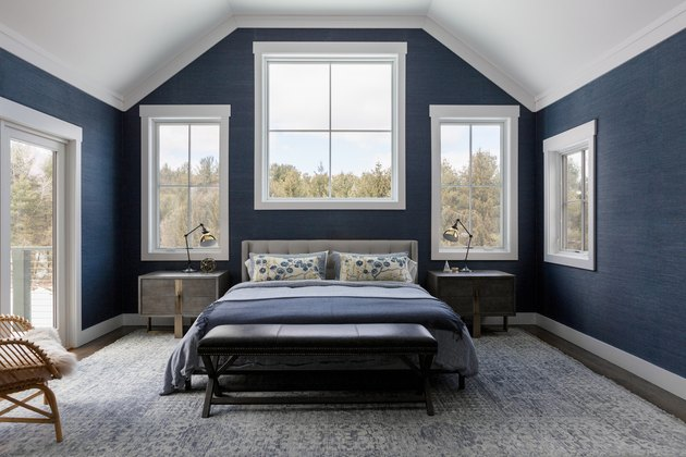 The master bedroom with navy grasscloth on the walls