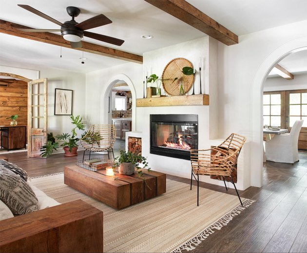 modern farmhouse mantel decorating idea in the living room with wood beams