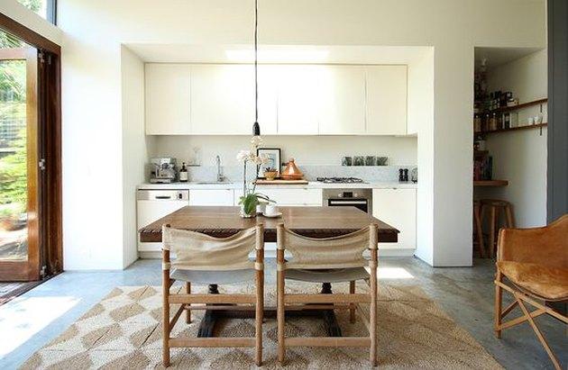 modern kitchen with concrete flooring