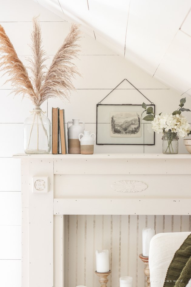 neutral farmhouse mantel decorating idea with white shiplap walls