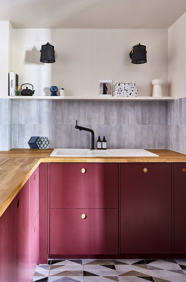 pink kitchen color idea with magenta cabinets and cement tile floor