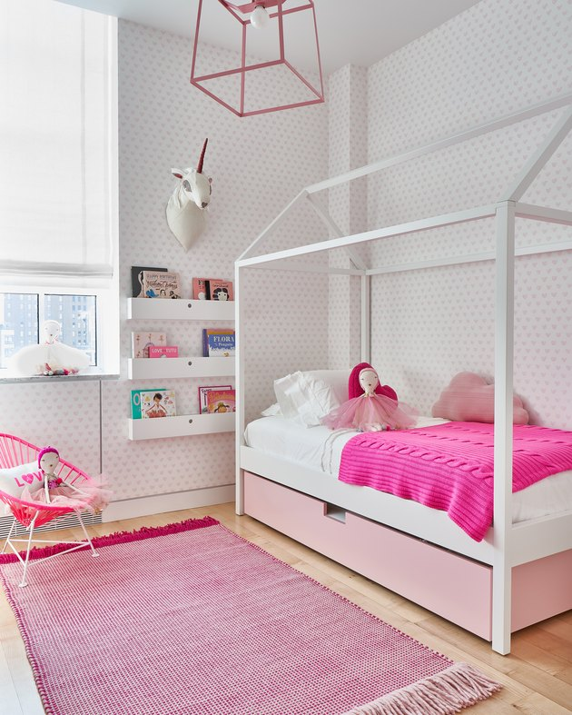 pink kids bedroom idea with Roman shade at window