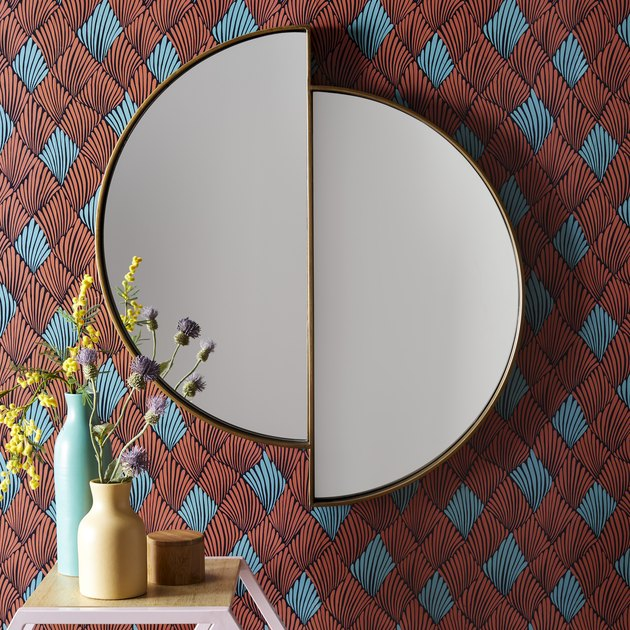 gold mirror on blue and red wallpaper