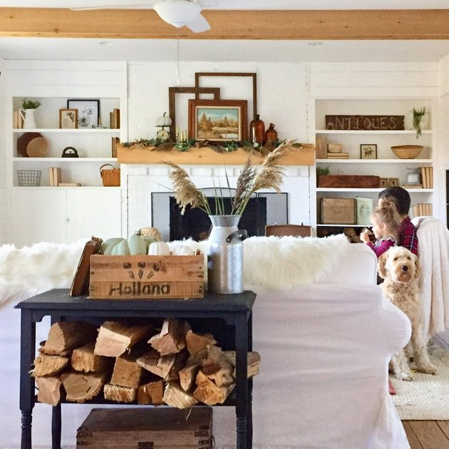 fall farmhouse mantel decorating idea with open shelving and exposed ceiling beams