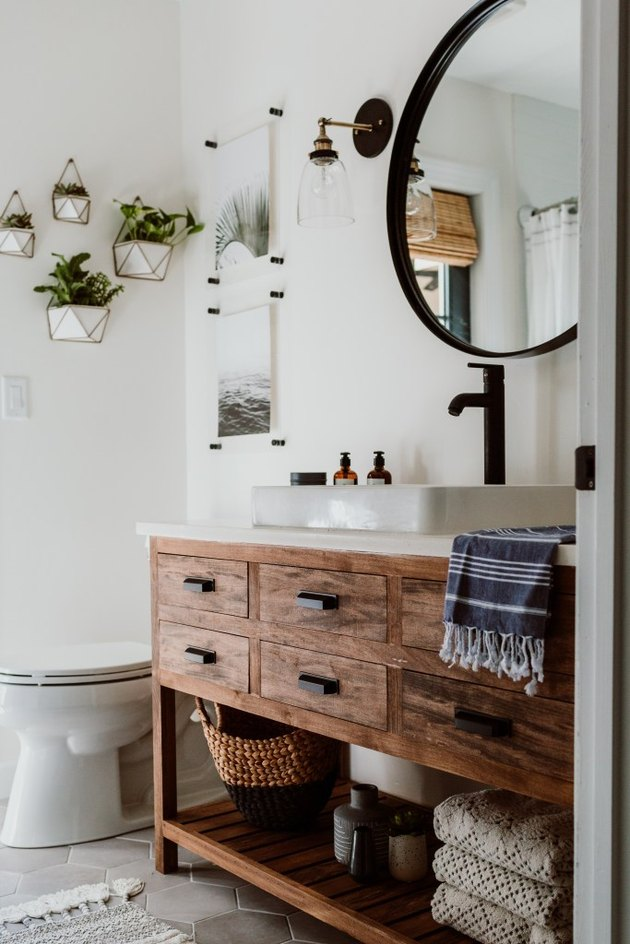 small farmhouse bathroom idea with wood vanity cabinet and self-rimming sink