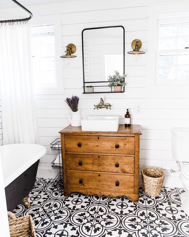 small farmhouse bathroom idea with patterned tile floors and repurposed vanity
