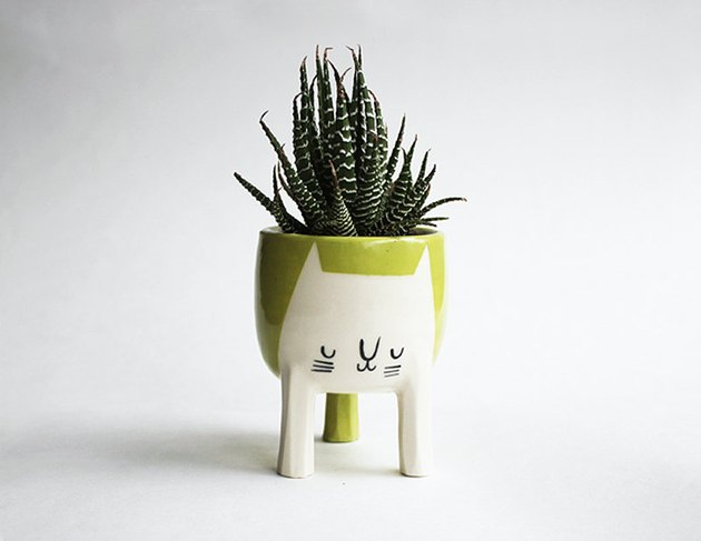 chartreuse three-legged cat planter