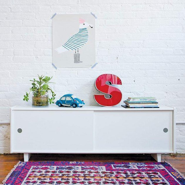 White console decorated with colorful toys