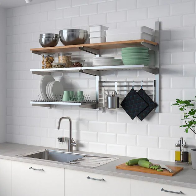 kitchen space with shelves on the wall