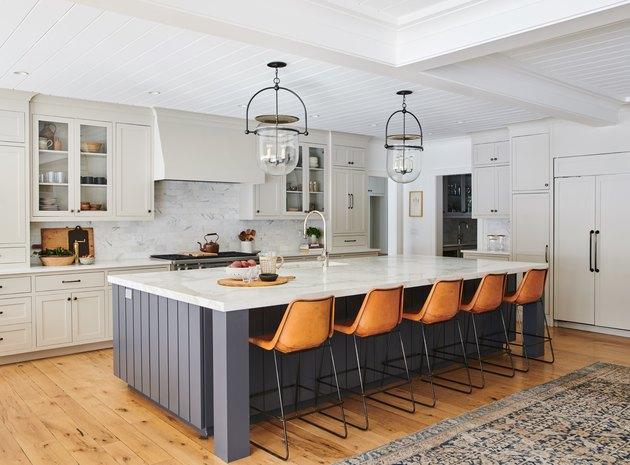 large black farmhouse kitchen island idea with leather stools