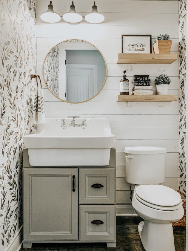 small farmhouse bathroom idea with shiplap backsplash and botanical wallpaper