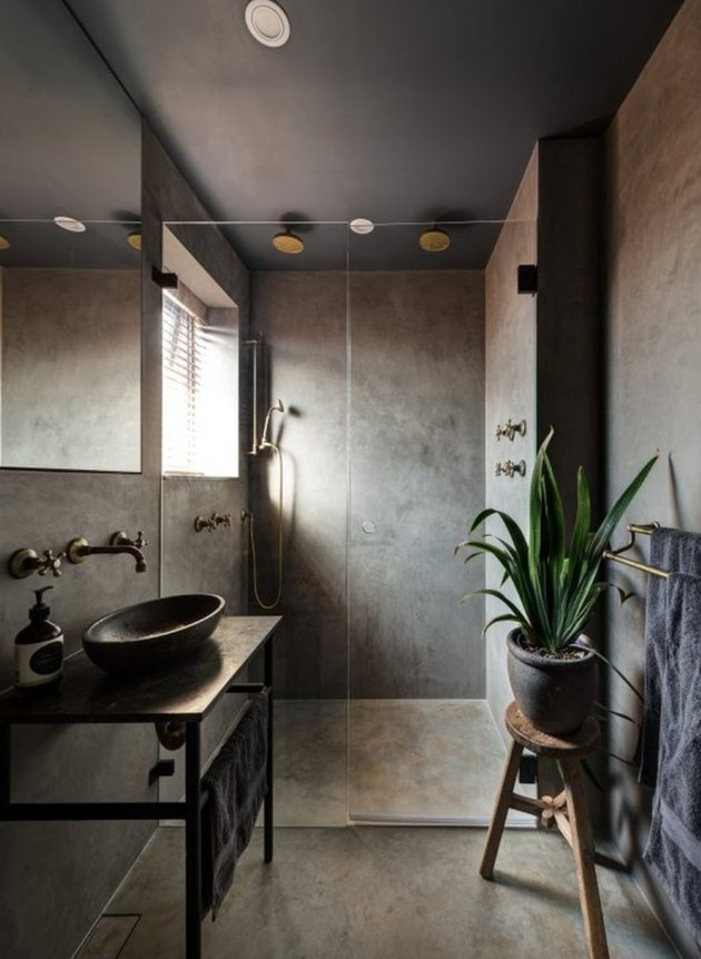 Deep grays and concrete create instant relaxation in this master bathroom.