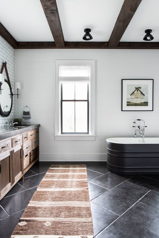 small farmhouse bathroom idea with black stock tank bathtub