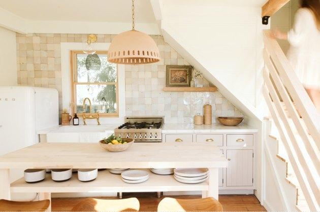 boho farmhouse kitchen island idea with shelving for dishware