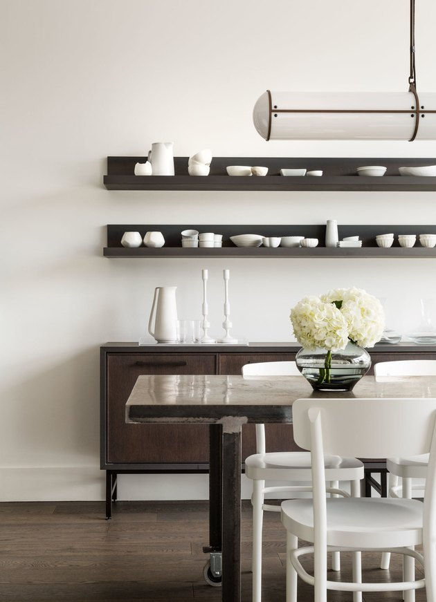 Dining Room Shelves above storage cabinet by Croma Design