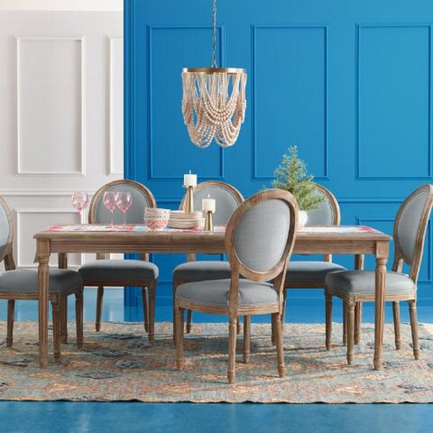 extendable shaker style farmhouse table idea with beaded chandelier and upholstered chairs