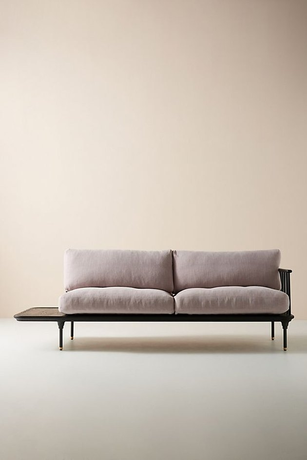 violet sofa with attached side table