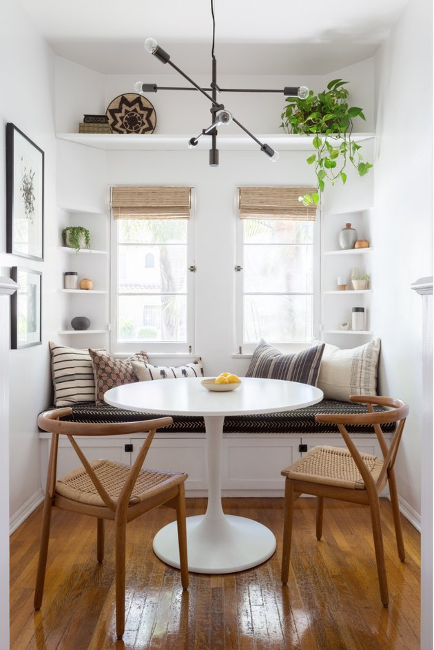 Small corner nook with dining room shelves by Katie Hodges Design