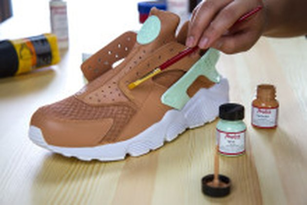 Painting leather shoes.