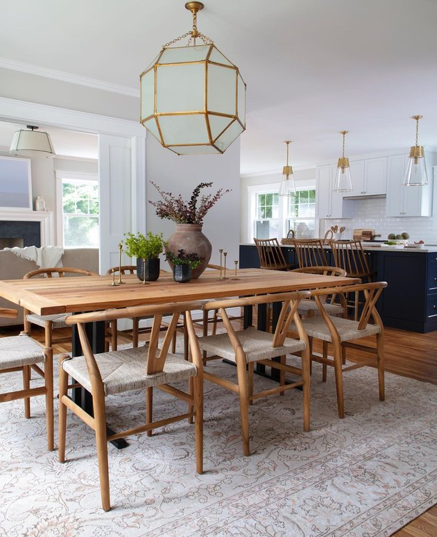 dining room table centerpiece with wishbone chairs gold oversize dining room light in casual dining room