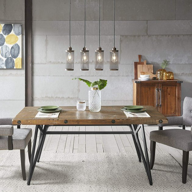 modern farmhouse table idea with metal base and upholstered dining chairs