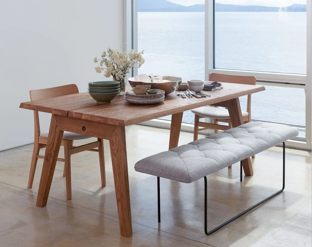 modern farmhouse table idea with chairs and a tufted bench