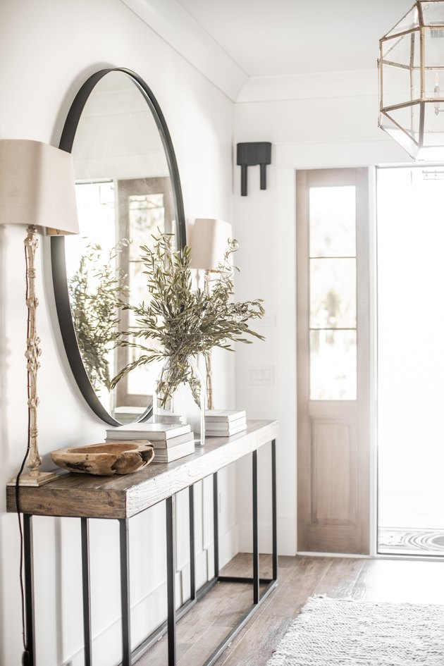 farmhouse entryway with huge mirror and wooden console